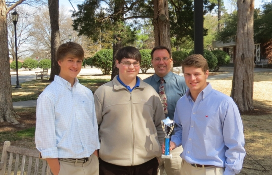 Economics team, from left, Grayson Lee, Zack Spisak, Mr. John Knaff and Witt Hawkins