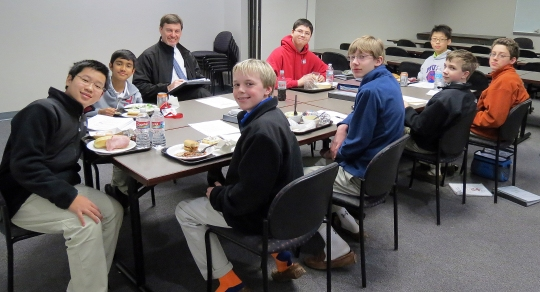 Lower School scholars have math for lunch – along with a side of Dining Hall offerings to prepare for Mathcounts competitions. Pictured, clockwise from left, are Chang Yu, Akaash Padmanabha, Mr. Loyal Murphy (instructor in math), Jacob Webb, Jet Tan, Ethan Hurst, Jackson Howell, Jackson Moody, and Rick Reinhard.