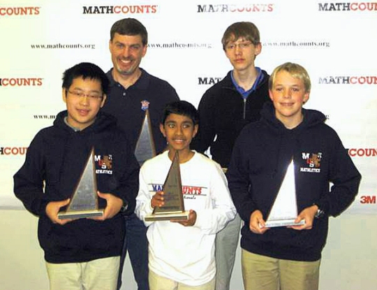The Owl first-place Tennessee Mathcounts team: from left, Chang Yu, Coach Loyal Murphy, Akaash Padmanabha, Jackson Moody, and Rick Reinhard