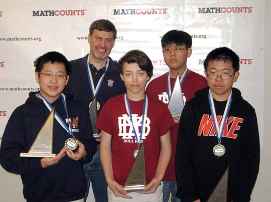 The Tennessee Mathcounts team advancing to national competition: from left, Chang Yu and Coach Loyal Murphy (Memphis University School), Mike Miccioli and Ray Lee (Montgomery Bell Academy); and Andrew Wu (White Station Middle School)