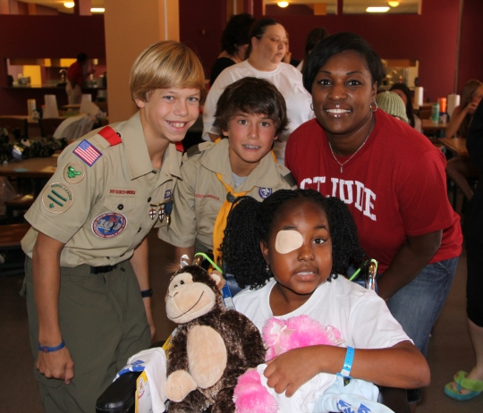 Preston Roberts, left, and Zachary Klinke in 2012 with friends at the Ronald McDonald House of Memphis, where they delivered Bears of Hope