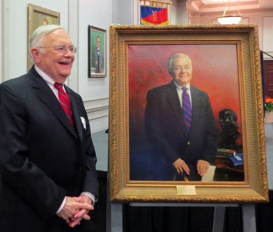 Mr. Jim Russell with his portrait, painted by Mr. Jie Ruan of Montgomery, AL