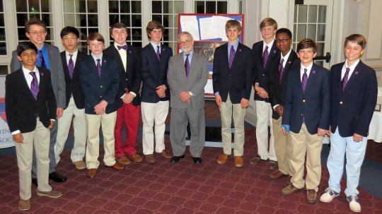 The 2015 Springfield Scholars gather around honorary scholar Mr. Terry Shelton in front of his framed tribute. Pictured, from left, are Zuhair Somjee, Ethan Hurst, Ethan Lam, Loyd Templeton, James Blatchford, Philip Wunderlich, Mr. Shelton, Ev Nichol, Sellers Shy, Ty Williams, William Quinlen, and Garrott Braswell.